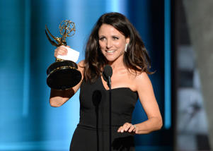 "IMAGE DISTRIBUTED FOR THE TELEVISION ACADEMY - Julia Louis-Dreyfus accepts the award for outstanding lead actress in a comedy series for ""Veep"" at the 67th Primetime Emmy Awards on Sunday, Sept. 20, 2015, at the Microsoft Theater in Los Angeles. (Photo by Phil McCarten/Invision for the Television Academy/AP Images)"