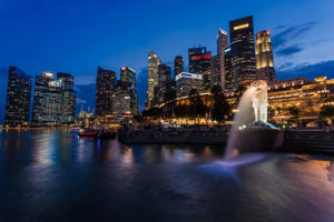 Sunset scene of Singapore skyline with merlion.