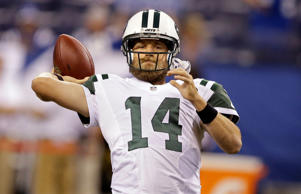 New York Jets quarterback Ryan Fitzpatrick throws before an NFL football game ag...