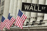 A sign hangs in front of U.S. flags outside of the New York Stock Exchange in New York