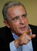 Colombia´s Senator and former President Alvaro Uribe gestures during an interview with The Associated Press in Bogota, Colombia, Thursday, Oct. 1, 2015. Uribe lashed out at what he considers a double standard by the international community for applauding a recent breakthrough in peace talks with leftist rebels that he says puts the country on a path toward more violence and impunity.