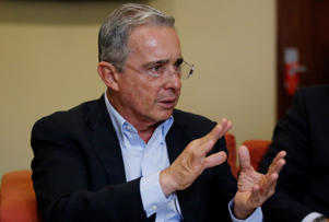 Alvaro Uribe: Colombia´s Senator and former President Alvaro Uribe gestures during an interview with The Associated Press in Bogota, Colombia, Thursday, Oct. 1, 2015. Uribe lashed out at what he considers a double standard by the international community for applauding a recent breakthrough in peace talks with leftist rebels that he says puts the country on a path toward more violence and impunity.