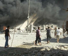 This image taken in Wednesday, Sept. 30, 2015 posted on the Twitter account of Syria Civil Defence, also known as the White Helmets, a volunteer search and rescue group, shows the aftermath of an airstrike in Talbiseh, Syria. Russia on Wednesday carried out its first airstrikes in Syria in what President Vladimir Putin called a pre-emptive strike against the militants. Khaled Khoja, head of the Syrian National Council opposition group, said at the U.N. that Russian airstrikes in four areas, including Talbiseh, killed dozens of civilians, with children among the dead.