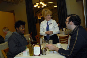 In this file photo, Susan Sowash, center, waits on Abram Bowie, left, and Chad Brickley at the Bacco restaurant in New Orleans