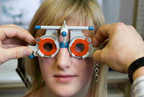 A young woman does an eyesight test
