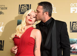 "Lady Gaga, left, and Taylor Kinney arrive at the Los Angeles premiere screening of ""American Horror Story: Hotel"" at Regal Cinemas L.A. Live on Saturday, Oct. 3, 2015. (Photo by Chris Pizzello/Invision/AP)"