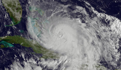 This satellite image taken Friday, Oct. 2, 2015 at 8:45 a.m. EDT, and released by the National Oceanic and Atmospheric Administration (NOAA), shows Hurricane Joaquin of the Bahamas. The Category 4 storm ripped off roofs, uprooted trees and unleashed heavy flooding as it hurled torrents of rain across the eastern and central Bahamas on Friday, and the U.S. Coast Guard said it was searching for a cargo ship with 33 people aboard that went missing during the storm.