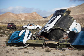 In this Nov. 1, 2014 file photo, wreckage lies near the site where a Virgin Galactic space tourism rocket, SpaceShipTwo, exploded and crashed in Mojave.