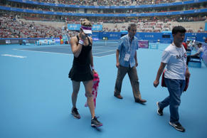 Eugenie Bouchard of Canada leaves the court after she retires injured in her match against Andrea Petkovic of Germany during the day three of the 2015 China Open at the China National Tennis Centreon.