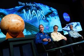 "John Grunsfeld, associate administrator at NASA's Science Mission Directorate, speaks during a press conference where NASA announced new findings that provide the ""strongest evidence yet"" of salty liquid water currently existing on Mars, as Jim Green (C), director of planetary science at NASA Headquarters; and Michael Meyer (R), lead scientist for the Mars Exploration Program at NASA Headquarter look on September 28, 2015 in Washington, DC."