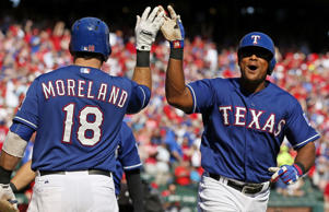 Adrian Beltre of the Texas Ranger, right, is congratulated by Mitch Moreland aft...