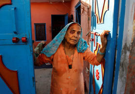 A bruised Asgari Begum, mother of 52-year-old Muslim farmer Mohammad Akhlaq, stands by the entrance of her home in Bisara, a village about 25 miles southeast of the Indian capital of New Delhi, Wednesday, Sept. 30, 2015.