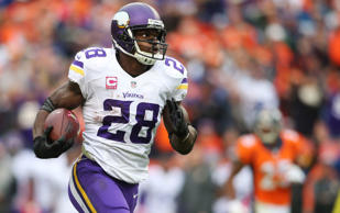 Minnesota Vikings running back Adrian Peterson runs for a touchdown during the s...