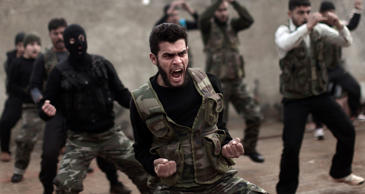 In this Dec. 17, 2012, file photo, Syrian rebels attend a training session in Ma...