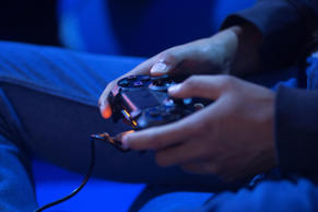 A gamer uses a Sony Corp. Playstation 4 controller to play a video game