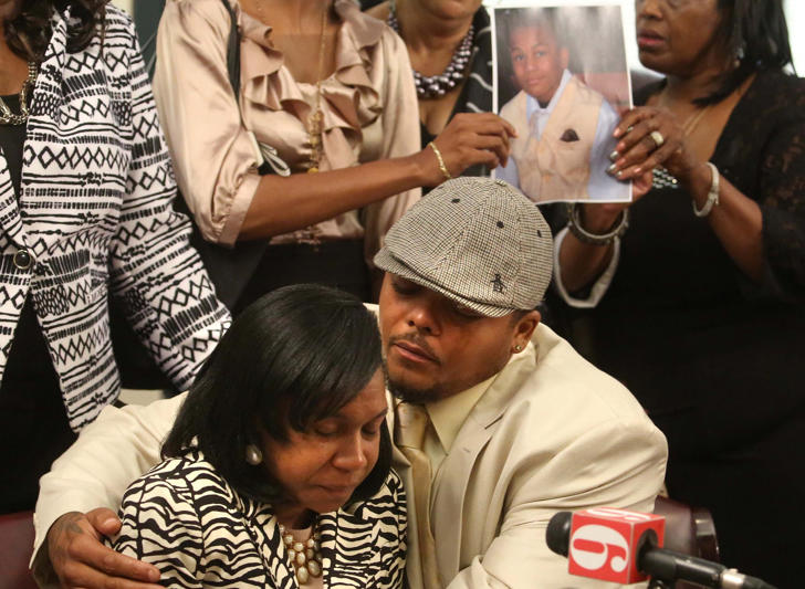 Shaniqua Hawkins is held by her husband Lamar, Sr. as she fights back tears at a press conference at Morgan & Morgan's office in Orlando as she blamed bullies for pushing her son, Lamar, a 14 year old middle school student, over the edge, saying she tried doing everything possible to help him.