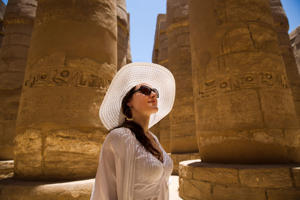 A tourist looks at the ruins of the Karnak Temple in Luxor, Egypt.