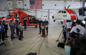 U.S. Coast Guard Lt. Commander Gabe Somma (L) stands next to U.S. Coast Guard Ca...