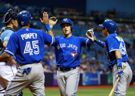 FILE: Toronto Blue Jays shortstop Darwin Barney (18) is congratulated by center fielder Dalton Pompey (45) and second baseman Munenori Kawasaki (66) as he hits a 2-run home run during the ninth inning against the Tampa Bay Rays at Tropicana Field.