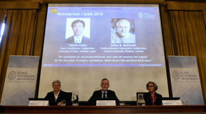 (L-R) Anne L'Huillier, member of the Nobel Committee for Physics, Goran K Hansson, Permanent Secretary of the Royal Swedish Academy of Sciences, and Olga Botner, member of the Nobel Committee for Physics, sit in front of a screen displaying the winners of the Nobel Prize in Physics 2015 Takaaki Kajita (L) and Arthur B McDonald during a press conference of the Nobel Committee to announce the winner of the 2015 Nobel Prize in Physics on October 6, 2015 at the Swedish Academy of Sciences in Stockholm, Sweden. Takaaki Kajita of Japan and Canada's Arthur B. McDonald won the Nobel Physics Prize for work on neutrinos.