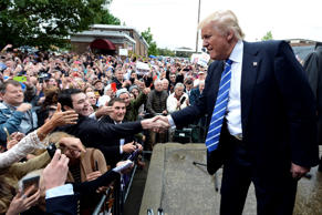Republican presidential candidate Donald Trump shakes hands with supporters after speaking at an event, Saturday, Oct. 3, 2015, in Franklin, Tenn.