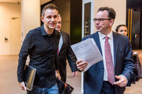 Max Schrems, left, and his lawyer Herwig Hofmann, right, walk in the hallway at ...