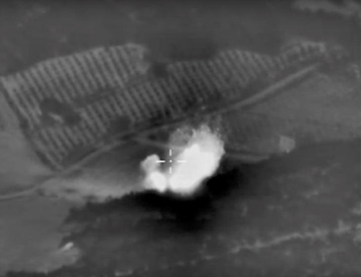 This photo made from the footage taken from Russian Defense Ministry official web site on Monday, Oct. 5, 2015 shows an attack made from a fighter jet in Syria. Russian Defense Ministry describes the incident as an airstrike against an ISIS ammunition depot near Talbiseh settlement (Homs). The object is completely destroyed.