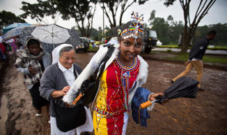 A Catholic sister and a Maasai woman arrive just after dawn in the rain and mud ...