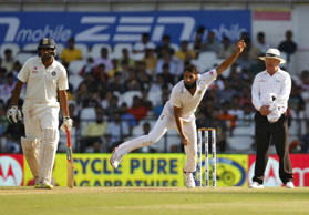 South Africa's Imran Tahir (C) bowls as umpire Ian Gould (R) and India's Ravichandran Ashwin look on during the second day of their third test cricket match in Nagpur, India, November 26, 2015