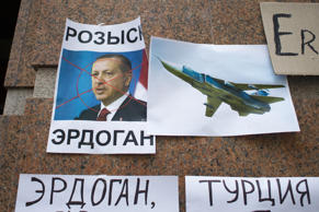 "Posters showing a portrait of Turkish President and reading ""Wanted,"" ""Erdogan, ..."