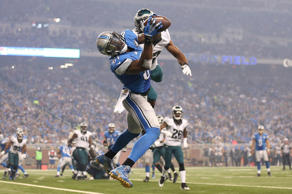 Wide receiver Calvin Johnson #81 of the Detroit Lions catches a third quarter touchdown in front of cornerback Eric Rowe #32 of the Philadelphia Eagles on November 26, 2015 at Ford Field in Detroit, Michigan.
