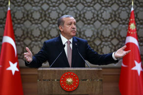 Turkish President Recep Tayyip Erdogan addresses a meeting of local administrators at his palace in Ankara, Turkey, Thursday, Nov. 26, 2015. Turkey has released audio recordings of what it says are the Turkish military's repeated warnings to the pilot of the Russian plane before it was shot down at the border with Syria. Turkey shot down the Russian Su-24 bomber on Tuesday, insisting it had violated its airspace despite repeated warnings. Erdogan said Turkey had not specifically targeted Russia when it shot down the plane.