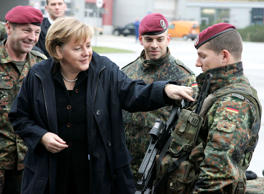 File: German Chancellor Angela Merkel speaks with soldiers during a visit to the German army at the barracks in Letzlingen, Germany, Tuesday, November 14, 2006.