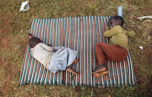 Burundian refugees sleep in the open at the Lake Tanganyika stadium in Kigoma western Tanzania, May 19, 2015.