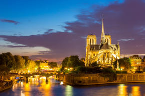 Notre Dame Cathedral with Paris cityscape and River Seine at dusk.