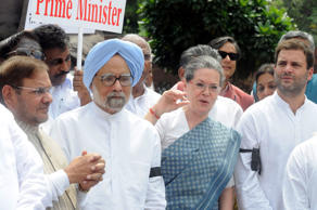 File: Congress President Sonia Gandhi, former Prime Minister Manmohan Singh with JD(U) leader Sharad Yadav and other Members of Parliament shouting slogans against Prime Minister Narendra Modi and the NDA government at Parliament House on August 6, 2015 in New Delhi, India.