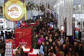 Customers stream into Macy's flagship store in Herald Square on Thanksgiving eve...