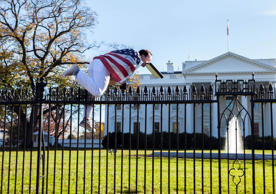 File: In this photo provided by Vanessa Pena, a man jumps a fence at the White House on Thursday, Nov. 26, 2015, in Washington.