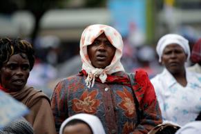 People attend a Mass celebrated by Pope Francis at the campus of the University of Nairobi, Kenya, Thursday, Nov. 26, 2015.