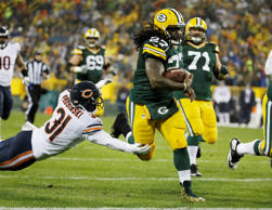 Green Bay Packers' Eddie Lacy runs for a touchdown during the first half of an NFL football game against the Chicago Bears Thursday, Nov. 26, 2015, in Green Bay, Wis.