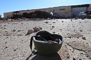 A helmet belonging to a Islamic State militant is seen on the ground at the 121 Regiment base after Fighters from the Democratic Forces of Syria took control of the base in the town of al-Melabiyyah, south of Hasaka city, Syria November 24, 2015.