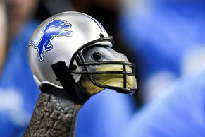 A turkey wears a Detroit Lions helmet during the NFL game on Thanksgiving agains...