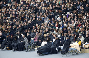 Wounded people in the Nov. 13 Paris attacks wait for the start of a ceremony in the courtyard of the Invalides in Paris, Friday, Nov. 27, 2015.