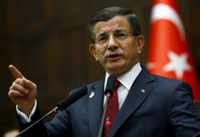 Turkey's Prime Minister Ahmet Davutoglu addresses members of parliament from his...