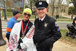 Philadelphia police Sgt. Phil McAlorum poses with Evan Megoulas at the Philadelphia Marathon, Sunday, in Philadelphia. McAlorum  was notified by Megoulas' family that something just might not be right.