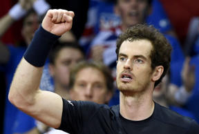 Britain's Andy Murray celebrates after winning his tennis match against Belgium's Ruben Bemelmans on the first day of the Davis Cup final between Belgium and Britain at the Flanders Expo in Ghent on November 27, 2015. AFP PHOTO / JOHN THYS