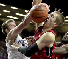 Kansas State's Dean Wade, left, and South Dakota's Tyler Hagedorn battle for a rebound during the second half of an NCAA college basketball game Friday, Nov. 20, 2015, in Manhattan, Kan.