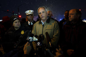 Colorado Springs police chief Pete Carey tells reporters that the shooting suspect at the Planned Parenthood center is in custody in Colorado Springs, Colorado November 27, 2015. Police arrested the gunman who stormed the Planned Parenthood abortion clinic in Colorado Springs on Friday and opened fire with a rifle in a burst of violence that left at least 11 people injured, including five officers, authorities said.   REUTERS/Rick Wilking