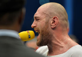 Britain's Tyson Fury sings after winning in a world heavyweight title fight for Ukraine's Wladimir Klitschko's WBA, IBF, WBO and IBO belts in the Esprit Arena in Duesseldorf, western Germany, Sunday, Nov. 29