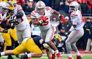 Ohio State Buckeyes running back Ezekiel Elliott (15) rushes for a touchdown in the first half against the Michigan Wolverines at Michigan Stadium.